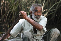 The man with an oar. Portrait. Bentota river, Sri Lanka. Stock Photography