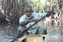The man with an oar. Portrait. Bentota river, Sri Lanka. Royalty Free Stock Image