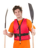 Man with oars. A man holding two oars wearing a life jacket, isolated on white Royalty Free Stock Images