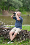 Man observing nature with binoculars Stock Photos