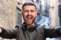 Man with an obsession for taking selfies selfitis.  stock images