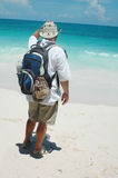 Man and Ocean. Man standing in front of the ocean looking out wearing a back pack and cowboy hat Stock Images