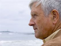 Man & Ocean. Elderly man looking thoughtfully out over the ocean Royalty Free Stock Photography
