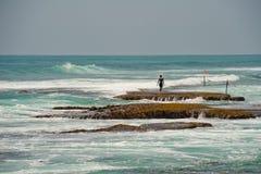 Man in the ocean. Sri Lanka royalty free stock photos