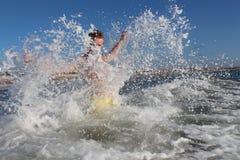 Man in ocean with water splash.  Stock Image