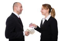 Man och kvinna med euro och dollaren Royaltyfri Fotografi