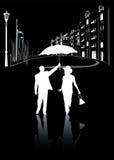 Man och kvinna som går i staden på natten i  Royaltyfria Foton