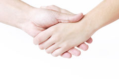 Man och kvinna som skakar händer, på vit Kvinnahand i fr arkivfoto