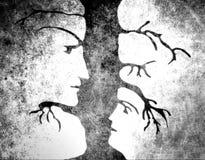 Man- och kvinnaframsidor i träd Arkivbilder