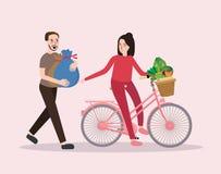 Man och kvinnlig för shopping för cykel för ridning för parköpgrönsak lycklig sund Royaltyfri Foto