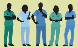 Man och kvinnligsjuksköterskor eller kirurger Arkivbilder