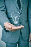 Man och lightbulb Arkivfoto
