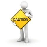 Man och vägmärke - varning Arkivfoto