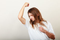 Man with odor of sweat Stock Photography