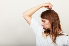 Man with odor of sweat Stock Image
