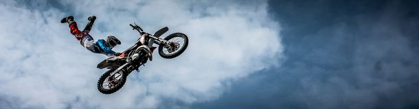 Man With Off Road Motorcycle Doing Tricks Royalty Free Stock Image
