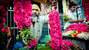 Man offer flowers near the temple India Royalty Free Stock Photos