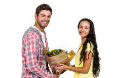 Man offering bouquet to his girlfriend Stock Images