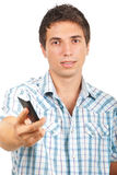 Man offering cell phone. Portrait of young man offering a cell phone isolated on white background,check also Business people Stock Photography