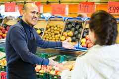 Man offering customer fruits Stock Image