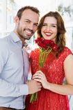 Man offering flower bouquet to woman Royalty Free Stock Photography