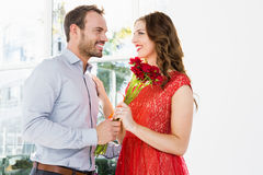 Man offering flower bouquet to woman Royalty Free Stock Images