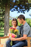 Man offering flowers to his girlfriend Stock Photo