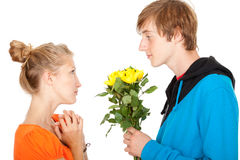 Man offering flowers to his girlfriend Royalty Free Stock Photos