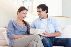 Man offering a gift to his fiance Royalty Free Stock Photos