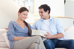 Man offering a gift to his girlfriend Stock Photography
