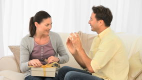 Man offering a gift to his girlfriend. At home stock footage
