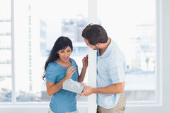 Man offering gift to his girlfriend Royalty Free Stock Photos