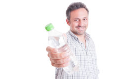 Man offering, giving a bottle of cold water Stock Image