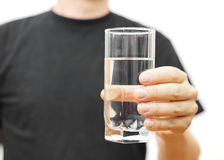 Man offering a glass of water Stock Images