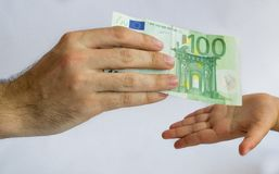 Man offering money to a child. Money in hands royalty free stock photography