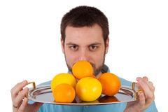 Man offering a plate with fruits Royalty Free Stock Images