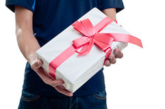 Man offering a present Stock Images