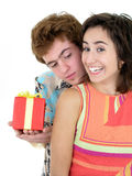Man Offering Present to Girlfriend Royalty Free Stock Photos