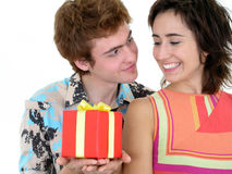Man Offering Present to Girlfriend Royalty Free Stock Images