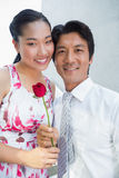 Man offering a red rose to girlfriend. On the stairs Royalty Free Stock Images