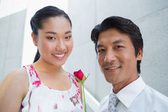 Man offering a red rose to girlfriend Stock Photography