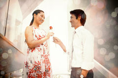Man offering a red rose to girlfriend Royalty Free Stock Images