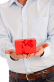 Man offering a romantic Valentines or Xmas gift Stock Images