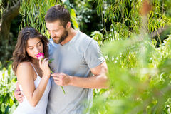 Man offering a rose to woman Royalty Free Stock Photography