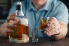 Man offering some shot of alcohol as a solution to your problems Royalty Free Stock Images