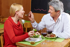 Man offering woman bite from fork Royalty Free Stock Photos