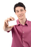 Man offering you a business card.Blur on the model, focus on the card. Young business man giving you a business card. Isolated on white background Royalty Free Stock Images