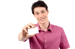 Man offering you a business card.Blur on the model, focus on the card. Young business man giving you a business card. Isolated on white background Royalty Free Stock Image