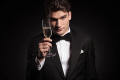 Man offering you a glass of champagne. Royalty Free Stock Photography