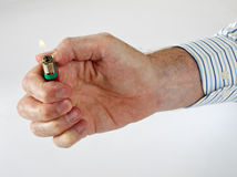Man offers cigarette  lighter Royalty Free Stock Photography